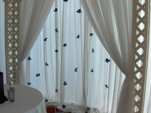 Canopy curtain with orchids